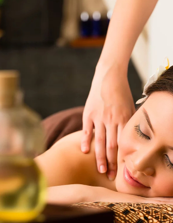 A Beautiful Woman Taken Massage in a Renowned Massage Center By A Massage Therapist.