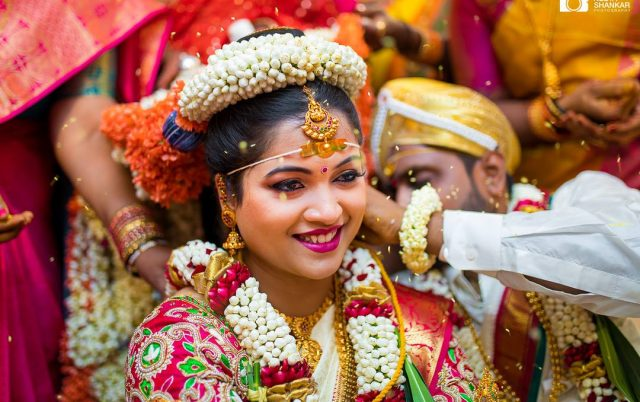 Image Representing A Close-up View of Stunning Indian Bride wearing a beautiful smile on her face during her Wedding Ritual.